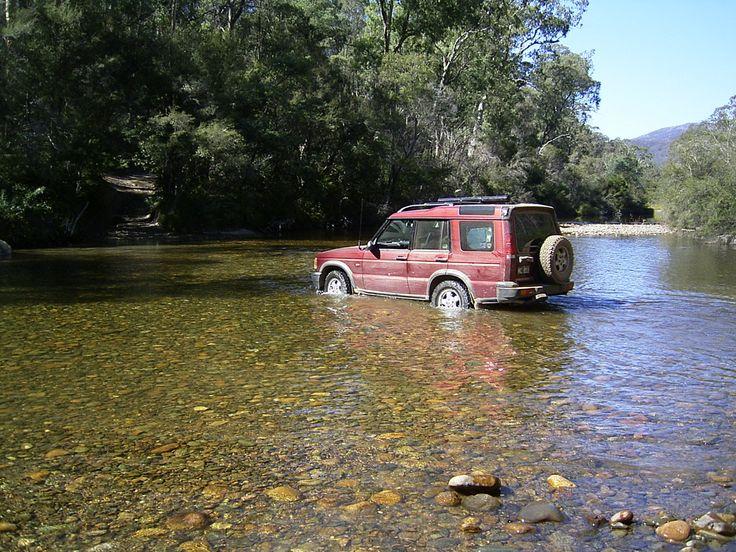 Sheron paddling the Disco across the stream near Kosciusko National Park
