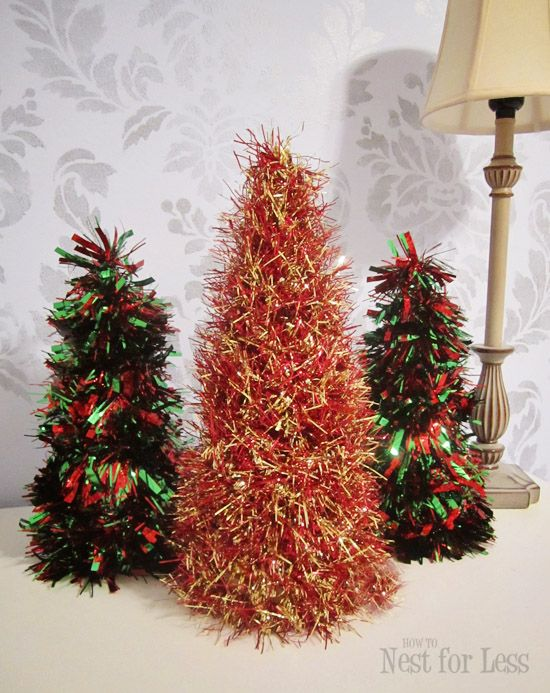 tinsel trees on cardboard cones....start at top of cone and hot glue tinsel, wrap around and voila! @ howtonestforless.com