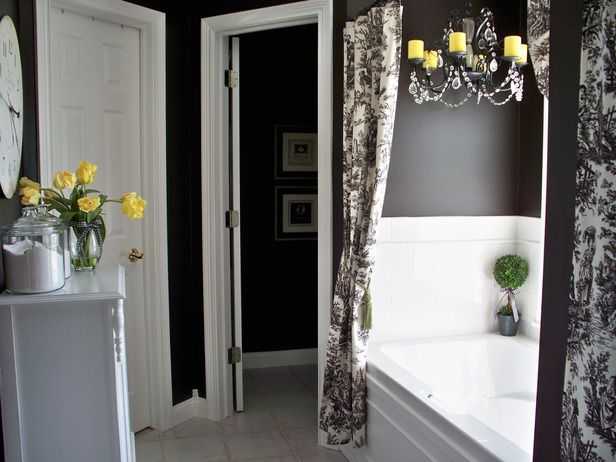 Sunny yellow pops in this elegant black and white bath.