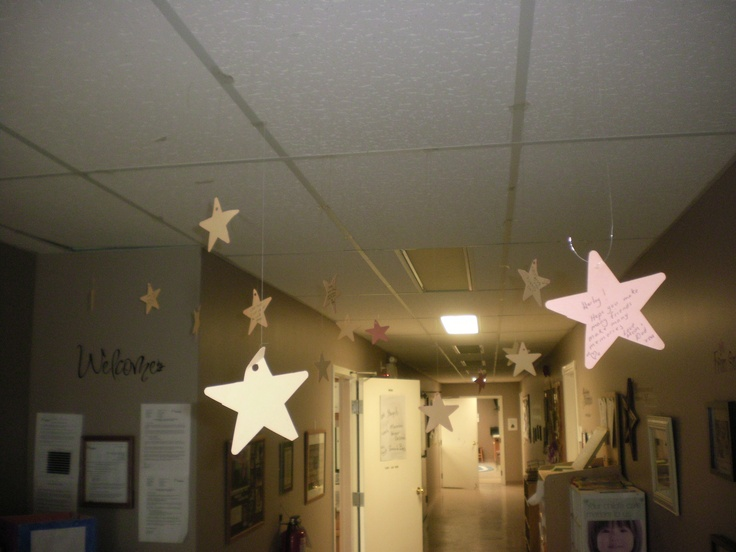 """Twinkle Twinkle Little Star, Do you know how loved you are?""  We have parents write a wish for their children on a star and then we hang them from the ceiling in our entrance."
