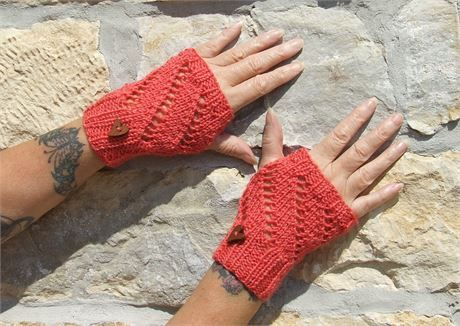 Ladies orange colour hand knitted wrist warmers - fingerless gloves - texting gloves Lacy knit gloves with patterned front and ribbed cuffs - heart shaped button   One size - 6 inches (15 cm) length x 7 inches (17cm) width Cold wash - wool acrylic mix  Colours may appear different on different monitors Please use zoom feature to see a clearer colour