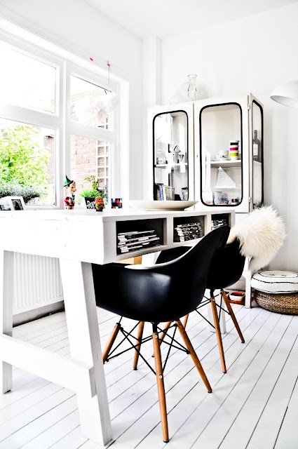 I'd love to work in here!!  super desk, cabinet chairs, floors & windows :)