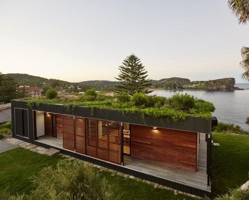 With a green roof and other sustainable elements this beach-side residence touches the earth lightly physically and metaphorically.