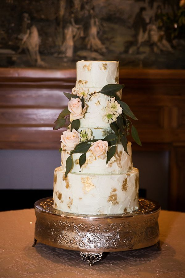The couple's four-tiered cake was brushed with edible gold. | Photo by Cadace Nelson