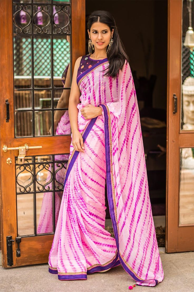 Chic and colourful leheriya alert! Another wavy wonder in shades of pink to keep your monsoon chirpy and stylish. nothing says chic like surprise details. And here we have a purple pink border to announce those details… We would say, do a cool purple blouse pairing! But a pink blouse pairing is just as nice. #pink #shaded #georgette #leheriya #saree #India #blouse #houseofblouse