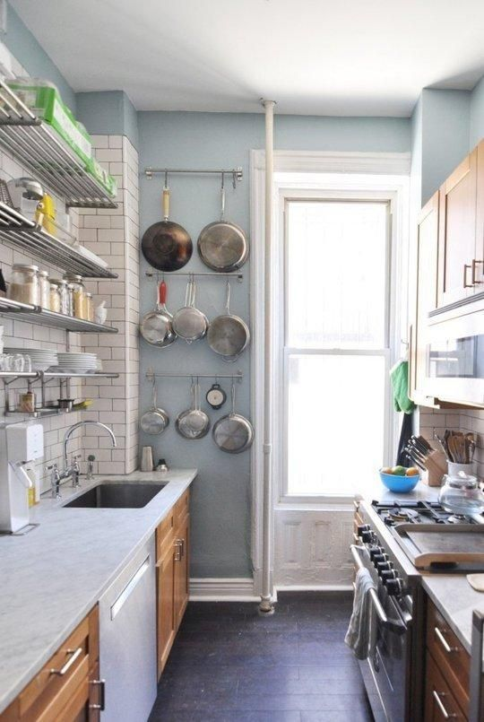 Small Kitchen Design Ideas Worth Saving... Shelving instead of top cabinets and hanging storage for pots
