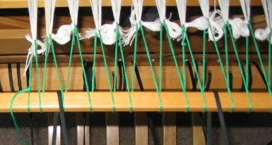 The warp is lashed onto the front apron rod.