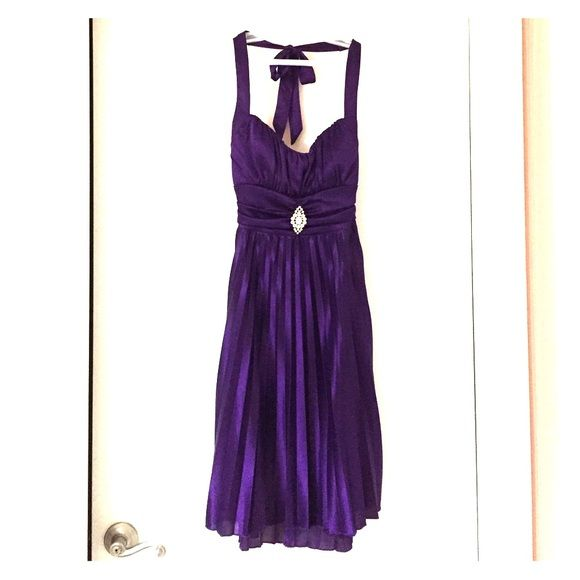 Purple formal dress Deep purple color with silky pleated material. There is an adjustable strap for the waist and neck. This was only worn once to a wedding. Speechless Dresses Midi