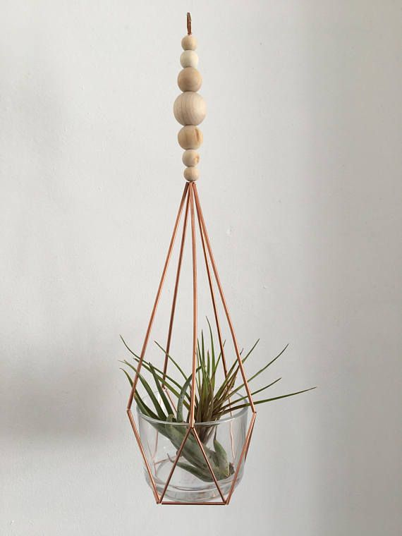 Hanging copper Himmeli planter with glass container and natural wooden beads:  This geometric hanging planter is handmade using copper tube in the himmeli style, with natural unfinished wooden bead detail and small glass container for plant.  Materials: • copper tube • copper wire • glass •