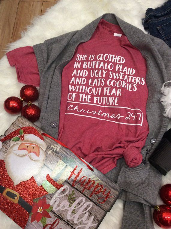 90fb9600ef She is Clothed in Buffalo Plaid and Ugly Sweaters and Eats Cookies Without  Fear of the Future. Funny Christmas Shirt. Short Sleeve Shirt.