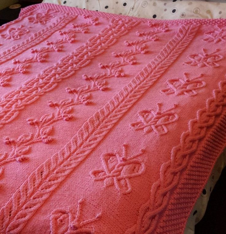 Free Knitting Pattern Butterfly Cabled Blanket - Joan Barnett designed this breathtaking cable afghan for Red Heart with 4 different cable patterns and a Bramble Stitch border.  58 x 66″ (147.5 x 167.5 cm)