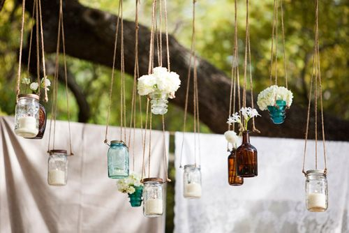 I love the mix of flowers and tea lights in these hanging vases!  I can't wait to do this in my own backyard!