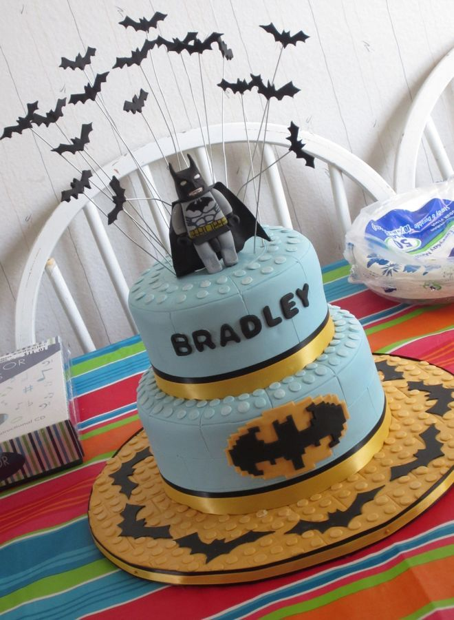 Batman Lego cake make for a 7th birthday. White chocolate raspberry cake filled with vanilla buttercream. Fondant covered, with fondant and gumpaste accents.