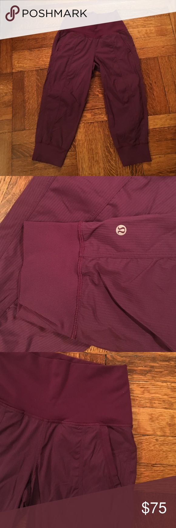 """Lululemon In Flux Crops, 6, purple/maroon Worn a handful of times...excellent condition. Thick elastic band around the waist and on the bottom cuffs. Slit side pockets. No back pockets. 13"""" at top and bottom, 30.5"""" length. Sorry...inside tag has been removed but it is definitely size 6 lululemon athletica Pants Capris"""