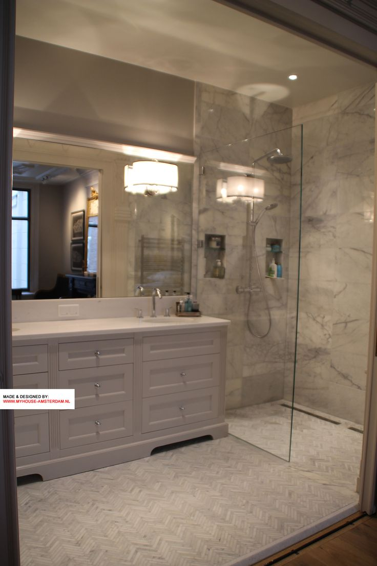Good view of a great bathroom design in Amsterdam by My House Interiors. It is perfect interior advice and design to have the nice transparent shower with nice light tiles. Also a great combination with the white marble top.