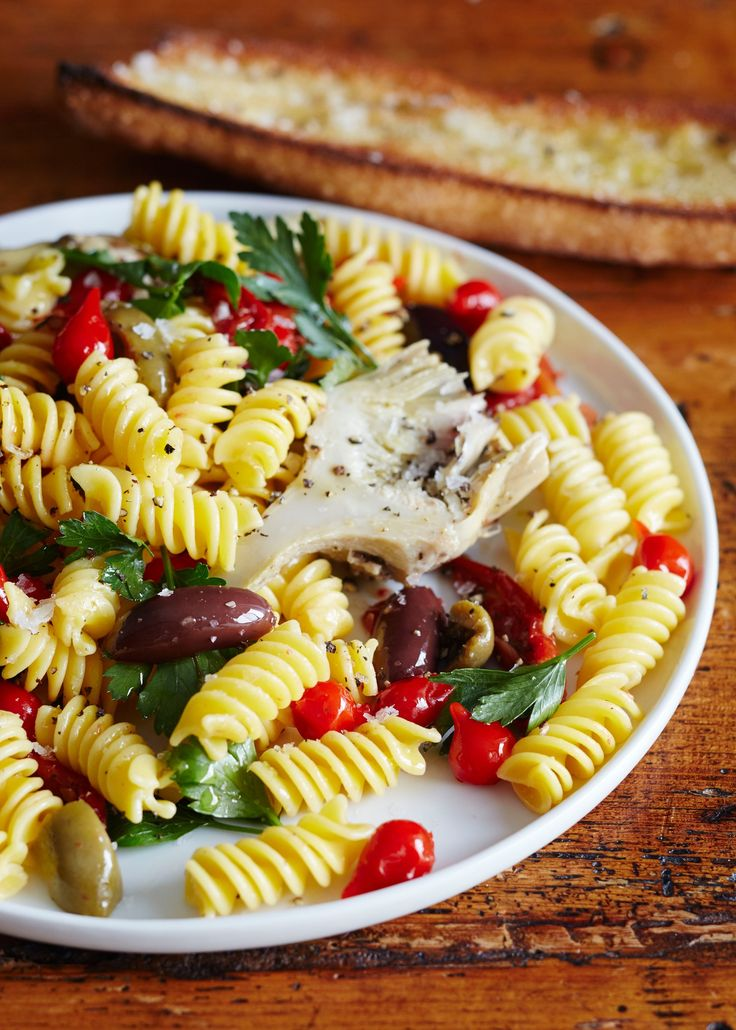 Antipasti Bar Pasta Recipe. Great grocery shopping tip to save time in the kitchen: load up on noodle salad toppings at the antipasti bar. This is an incredibly quick and EASY meal to throw together on those nights where you have no idea what to make for dinner. Who could say no to this simple Italian creation?
