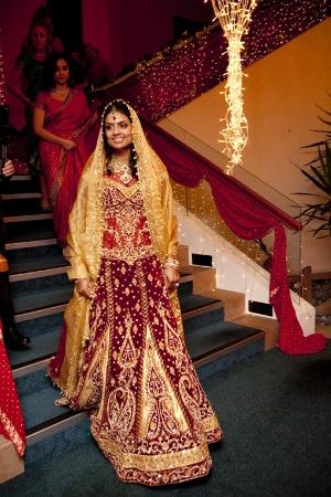 Bride in Maroon & Gold Lengha