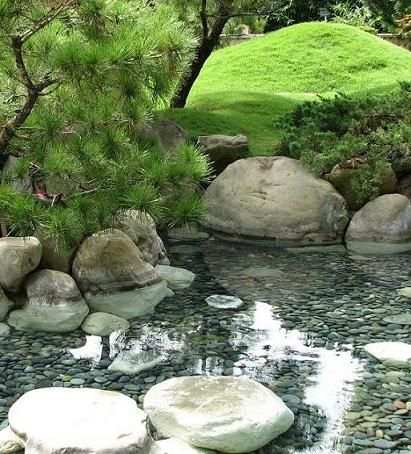 WISHFUL THINKING I want a pond like this in my garden, but it would take up the whole garden
