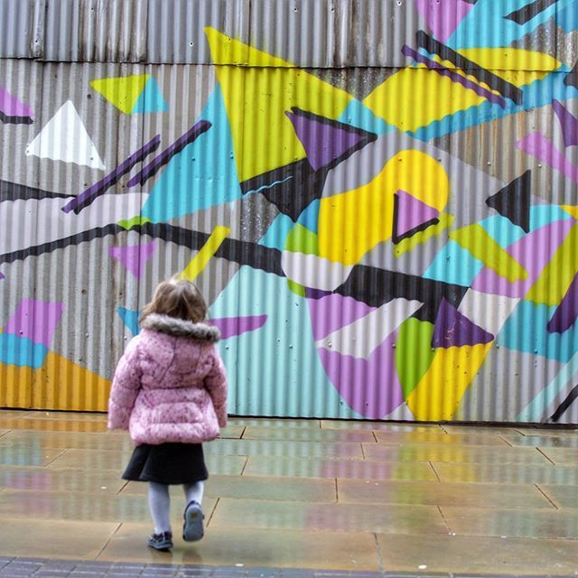 You know you've corrupted your child when she automatically marches to colourful walls to have her picture taken 😂 This was taken outside the geometric mural at Beat Street, Deansgate, Manchester