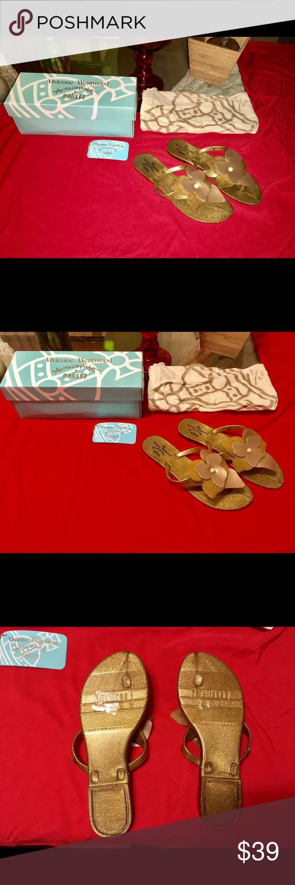 Vivienne Westwood Melissa Sandals Gold Flip Flop Comes Brand New w Box, Tag, and Dustbag. 100% Genuine Vivienne Westwood Melissa Sandals. Super comfy and super cute gold glitter flip flops with a gorgeous handmade flower. Melissa Shoes Sandals