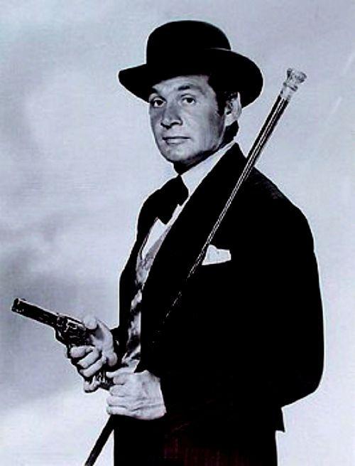 """Bat Masterson. No velho oeste ele nasceu, e entre os bravos se criou, seu nome em lenda se tornou Bat Masterson Bat Masterson.."""" Um dos preferidos de papai.."""