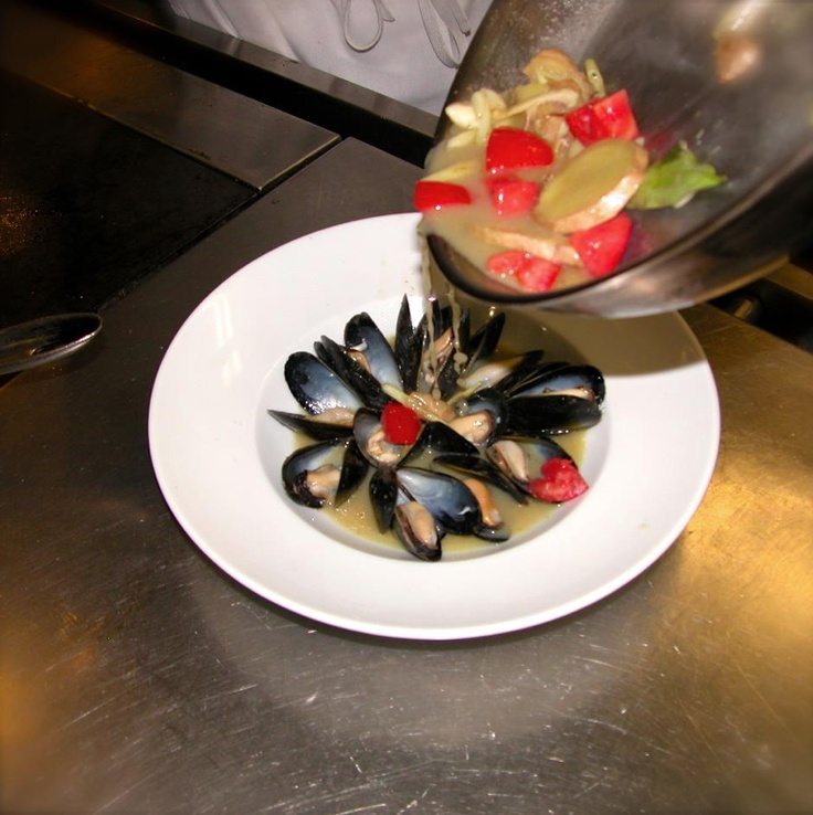 Fresh #PEI #mussels in a spicy green curry broth with mint & cilantro at the Wilshire Restaurant in Santa Monica, CA. www.peiflavours.ca