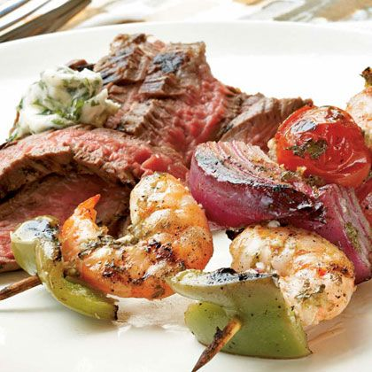 Ginger-Lime Marinated Shrimp Kebabs with Grilled Flank Steak and Cilantro Butter | MyRecipes