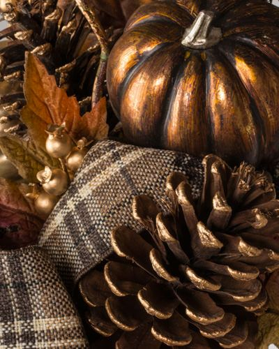 Metallic pumpkins, autumn foliage, and artfully arranged plaid ribbon accent adorn Balsam Hill's Autumn Shimmer Foliage.
