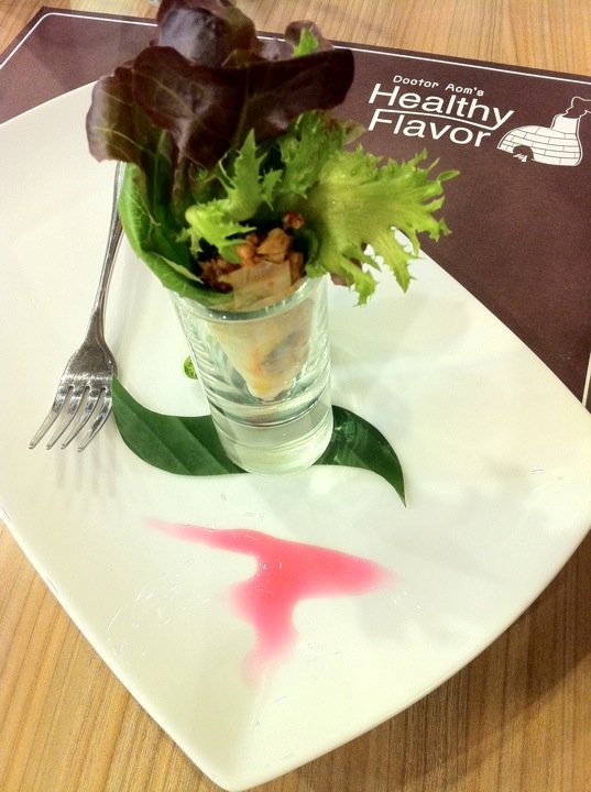 """""""Mieng (เมี่ยง) with Stirfried fish and Herbal things"""". Thai traditional way of cooking is a daily health promotion itself. With a little twisted in presentation, this has a look of contemperary finger food with a bit of decoration pink sauce made from Red indian wood coloring."""