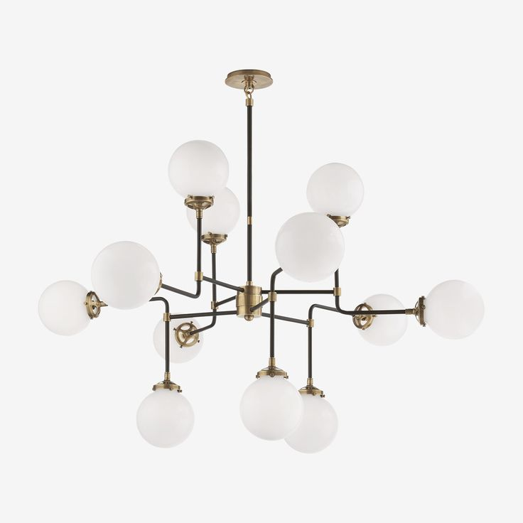 The Bistro Chandelier in Hand-Rubbed Antique Brass with White Glass by Ian K. Fowler • This 12 light hanging chandelier is a Mid-Century Modern charmer. The Bistro makes its mark with its irregularity and then nails it with its stunning finishes and surprising beauty. These finishes make it a perfect match for an array of home interior styles and work just as well in a commercial environment.