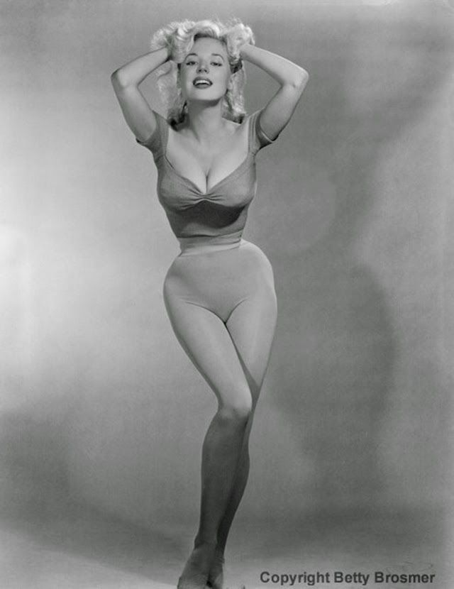Betty Brosmer might be the most famous model you've never heard of. A busty blonde with an impossibly small waist — her measurements were of...