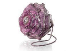 Top Ten Most Expensive Bags and Purses in the World 7. Leiber Precious Rose Bag - $92,000     The Precious Rose is in the shape of a perfect flower, the bag has 1,016 diamonds totaling 42.56 carats, 1,169 pink sapphires and 800 tourmalines. There is only one available in the world.