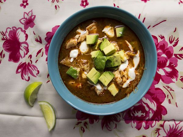 Sopa Azteca, or tortilla soup, is a simple and classic Mexican dish. Topped with avocado, cheese, and crema, this soul-satisfying soup is perfect pretty much any time of year.