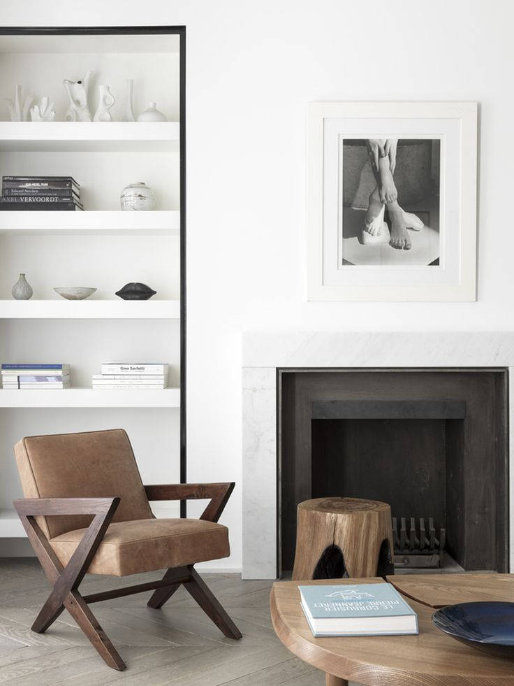 SHELF INSPIRATION - Architect Nicolas Schuybroek highlights a collection of books and pottery with a contrasting frame of black. Photography by Stephan Julliard.