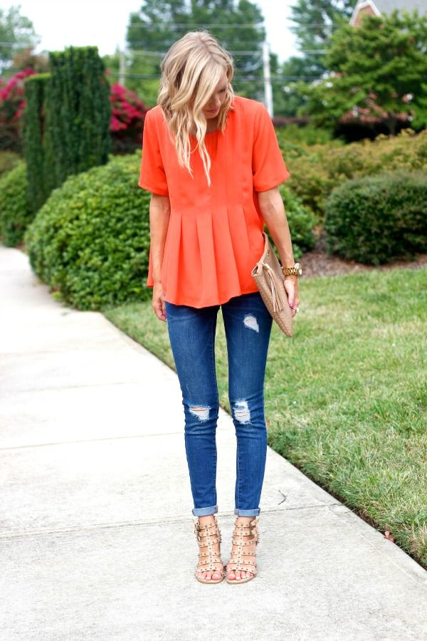 Spring / Summer - street chic style - coral short sleeve round neck peplum blouse + dark ragged skinnies + nude strappy heels + nude clutch