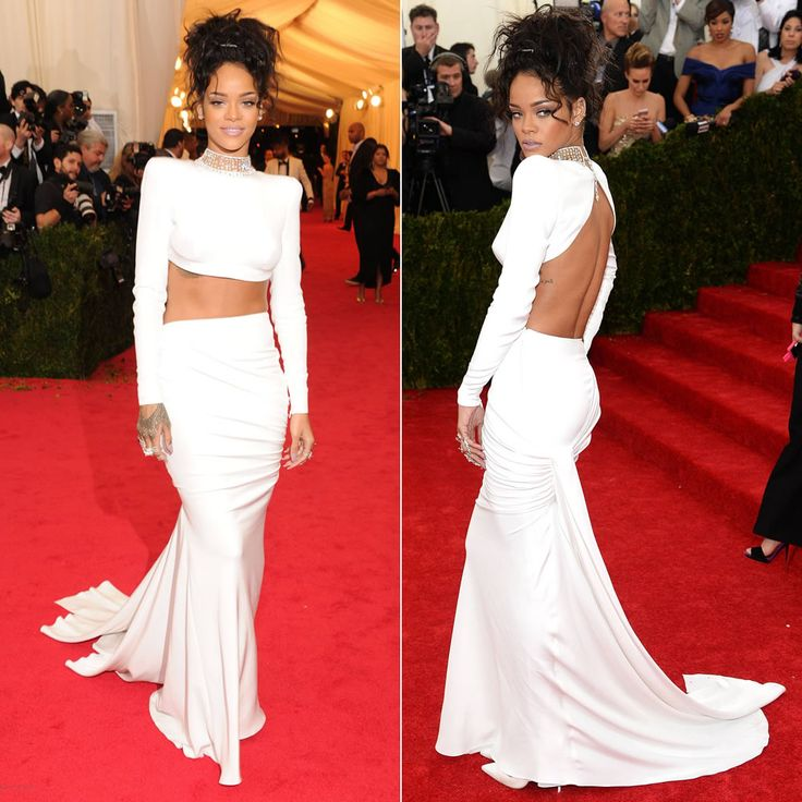Rihanna at the 2014 Costume Institue Met Gala in white Stella McCartney croppted top and skirt, Christian Louboutin pumps, Jacob & Co diamon...