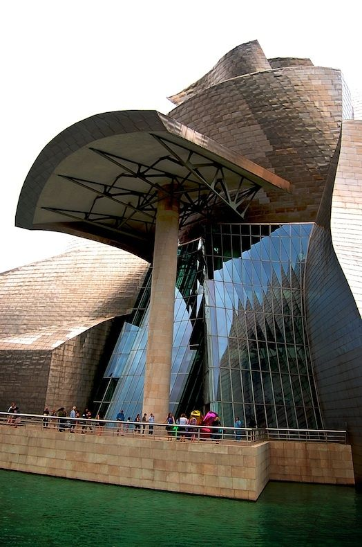 AD Classics: The Guggenheim Museum Bilbao / Frank Gehry. ArchDaily article on the twentieth anniversary of the beginning of construction of Guggenheim Museum Bilbao. Spain. Frank Gehry (architect). 1997 C.E. Titanium, glass, and limestone.