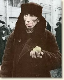 A starving man holds his daily ration of bread.  The siege of Leningrad, 1941-1944  World War 2