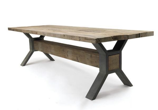 The ultimate rustic industrial dining table. Sturdy steel X trestles and a rustic solid square beam support a reclaimed pine top with a wipeable, waxed finish.