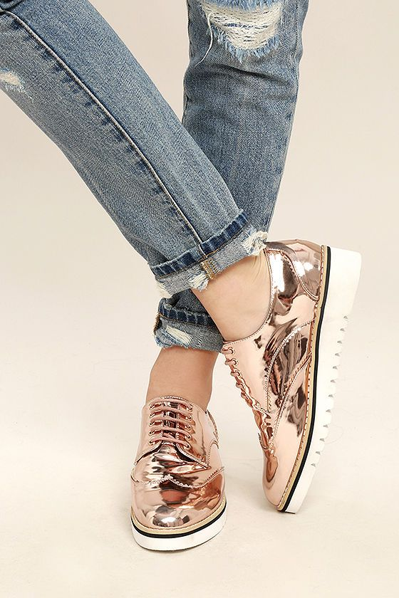 """Are you ready to see the coolest shoes on the street? Then take a look at the Aurelia Rose Gold Patent Platform Oxfords! Shiny rose gold vegan leather forms these chic oxfords with a rounded, wingtip toe, lace-up vamp, and top-stitched welt. Beige, black, and white, 1.5"""" rubber sole."""