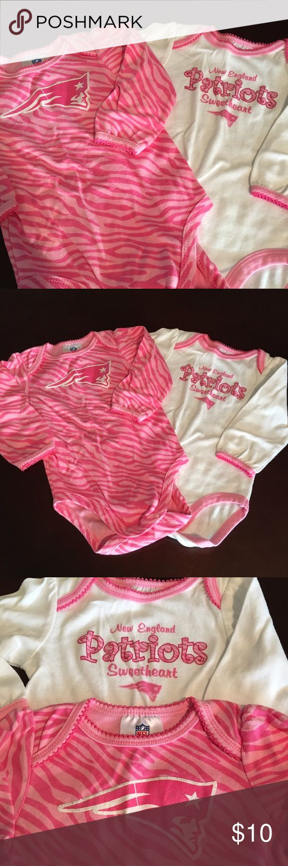 Girl's NFL New England Patriots onesies- 18 months #117.  Authentic NFL team apparel.  Let your little girl show her Patriot pride for the 2017 Super bowl champs!! VGUC long-sleeved onesies.  Very minor wash wear as seen in last pic.  SF/PF home.  **Please check out my closet.  Lots of girls things.  10% discount on bundles**.  Tags: New England, football, champions, Pats NFL Team Shop One Pieces Bodysuits