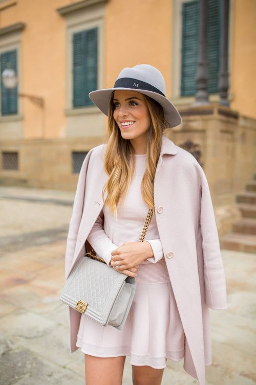Julia Engel is wearing a blush pink outfit, coat from Max Mara and the top and skirt is from Parker