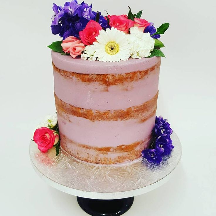 Purple Naked cake with fresh flowers