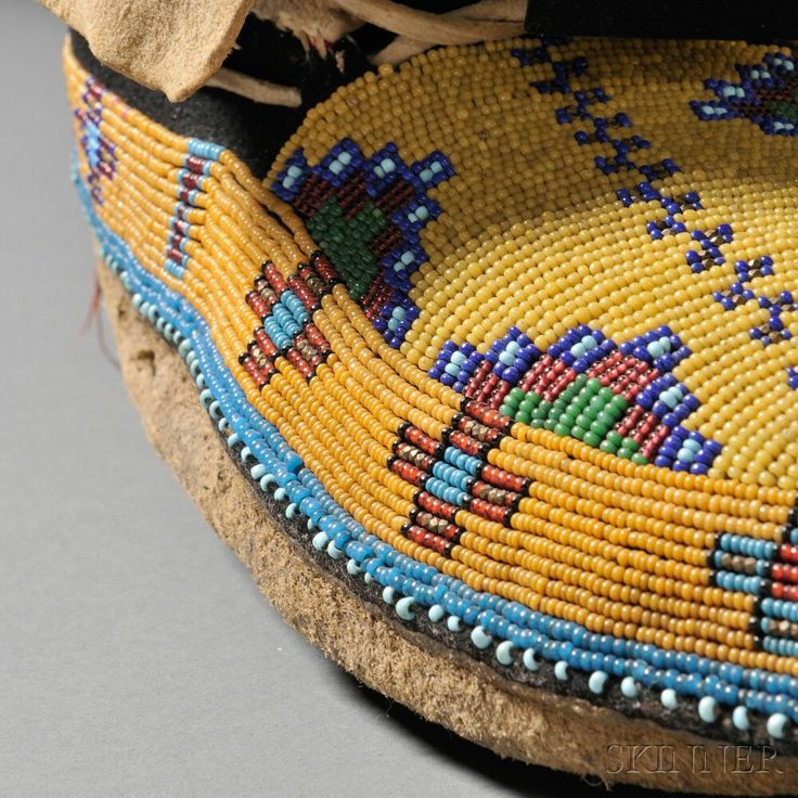 Pair of Plains Cree Beaded Buffalo Hide Man's Moccasins
