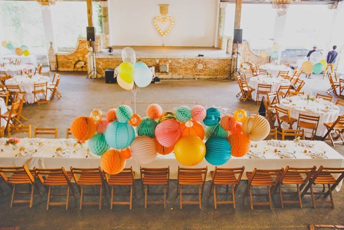 paper lanterns, paper decor | Barn wedding decor - bright colors - www.under-the-paper-lantern.com