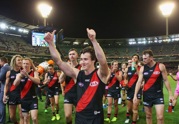 Andrew MGrath of the Bombers celebrates the win with fans during the round one AFL match between the Essendon Bombers and the Hawthorn Hawks at Melbourne Cricket Ground on March 25, 2017 in Melbourne, Australia.