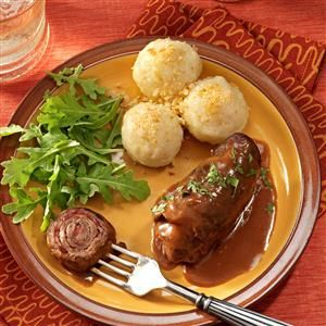 Beef Rouladen Recipe -Our family was poor when I was growing up in Germany, so we ate garden vegetables for many weekday meals. When Mother made meat for a Sunday dinner, it was a terrific treat. My favorite is this tender beef dish, which gets great flavor from Dijon mustard. -Karin Cousineau, Burlington, North Carolina