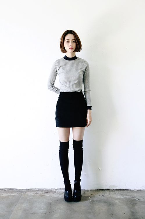 Grey shirt, black skirt, black knee-high socks, black booties