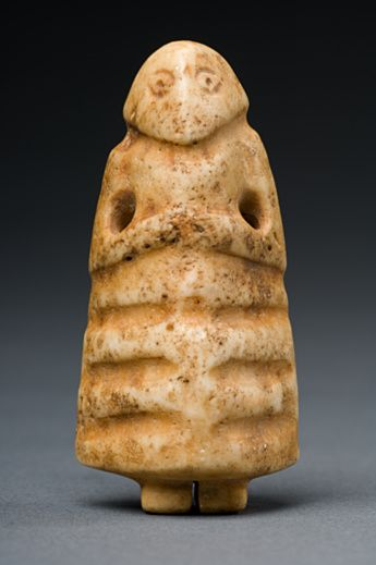 "Mesopotamian Stone Votive Figure, 3rd millennium BCE. ""Votive statues in an attitude of prayer originated in Mesopotamia at the beginning of the third millenium BC. They were placed in temples to represent the donor in perpetual prayer before the gods. As this small figure is pierced, it may have been worn as an amulet."""
