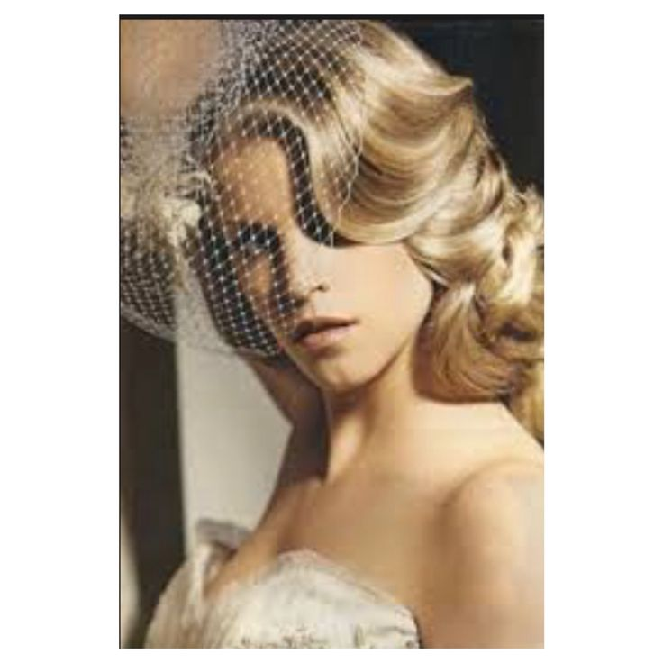 Pretty take on curled/down bridal hairstyle